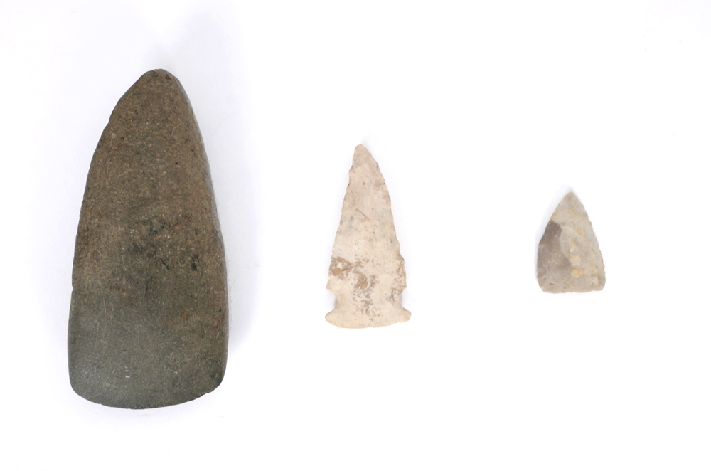 8th century AD polished stone axe head and two Clovis arrow heads. at Whyte's Auctions