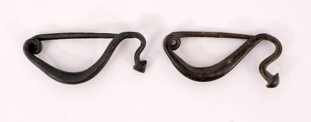 Circa 300BC. Pair of Iron Age Celtic la tene type bow brooches, 28-30mm in length. at Whyte's Auctions